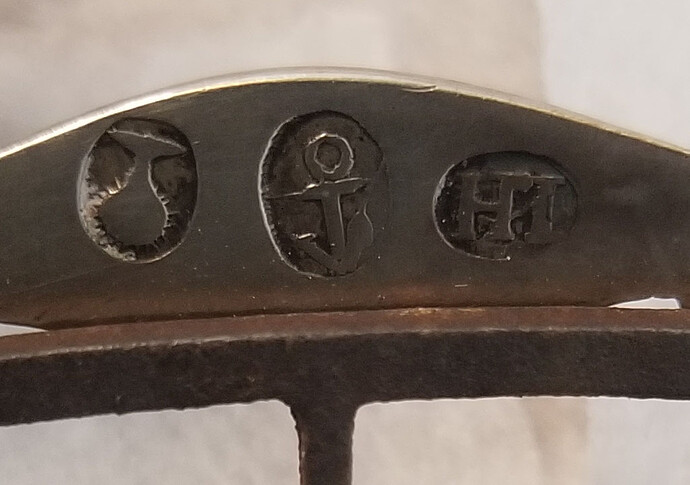 silver marks on buckle