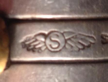 Tiffany mark S in wings.JPG